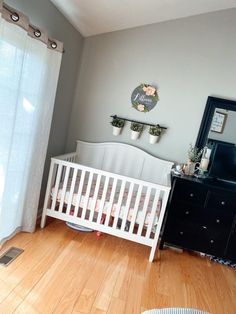The cutest little mini nursery in the corner of a master bedroom! Absolutely love the clean white crib and florals! #farmhouse #farmhousenursery #girlnursery Small Space Nursery, Cozy Reading Corners, Nursing Chair, Girl Nurseries, Small Master Bedroom, Baby Necessities, Nursery Ideas, Cribs, Small Spaces