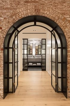 Raad Studio turns Tribeca lofts with exposed arches into huge apartment