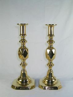 Pair of Antique 'Queen of Diamonds' Brass Candlesticks.  Octagonal bases with diamond stems.  Each stamped to base with 'Queen of Diamonds.'  Dating from the late 19th Century - circa 1897 in celebration of Queen Victoria's Diamond Jubilee.  Mellow patina of aged brass.