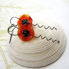 Glass poppy earrings by THEAjewellery I wonder if you could recreate this with recycled plastic bottles