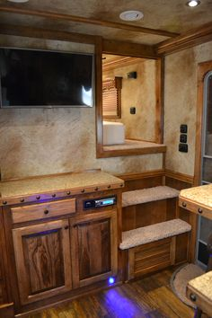 Outlaw Conversion with entertainment center, large LED TV, courtesy lights and enclosed nose. Living quarter trailers, horse trailers, luxury living quarters