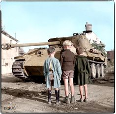 Three French boys looking at a knocked-out Panzer V 'Panther' in the Falaise pocket, Normandy. 25 August 1944. (IWM 9665)