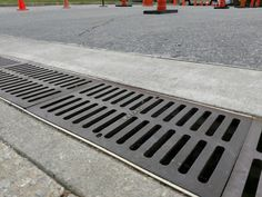 Heavy traffic cast iron drain grate for the NDS® Pro Series 12 trench drain system. Shop our online store or contact us today for your more complex projects at Luxury Home Decor, Luxury Homes, Trench Drain Systems, Backyard Drainage, Cast Iron, It Cast, French Drain, Drain Cover, Sustainable Design
