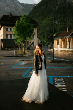 Bride wears a leather jacket for her Elegant After The Wedding Portrait Shoot | Photography by http://landofwhitedeer.com/