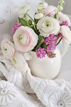 Pretty white and pink flowers in a white jug