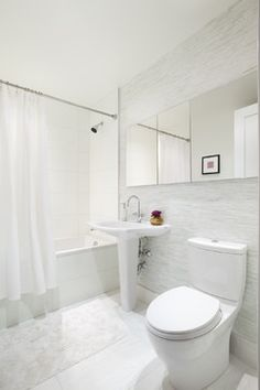 Bathroom - modern - bathroom - new york - Prestige Custom Building & Construction, Inc.           I'm not sure how I feel about such a white bathroom, but they say it makes smaller spaces look a little more spacious.  Perhaps adding colorful accents via wall hangings and towels, etc. could be sufficient coloring?