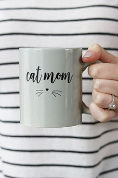 "I'm not like a regular mom, I'm a cat mom. Details: - 11 oz. - Ceramic Grey - 4.5"" W x 3.75"" H - Ships in a protective mug box - Hand wash recommended, microwave safe"