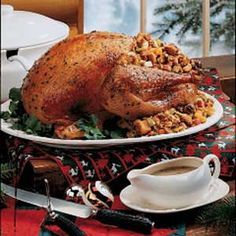 Herbed Turkey and Dressing Recipe_    Whenever I serve this succulent golden turkey and delectable dressing, guests fill their plates and I'm buried in compliments. This recipe always makes a holiday dinner one to remember. It's well worth the time. -Marilyn Clay, Palatine, Illinois    This recipe is:    Contest Winning