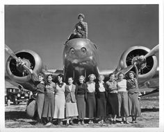 Sept. 20, 1936 photo provided by Purdue University, Amelia Earhart sits on top of her Lockheed Electra plane with a group of Purdue coeds in front.