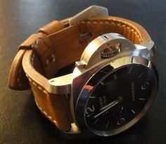 Cool combo; PAM312 on vintage WWII French Ammo strap