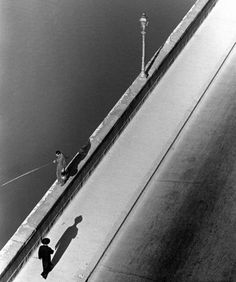 ALFRED EISENSTAEDT    Sunday morning along the Arno River. 1935