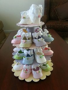 This unique centerpiece is perfect if youre looking for both shower favors and a centerpiece for your upcoming event. The stand has three tiers that can hold 25 pastel colored shoe favors (included) Height of the stand with the shoe topper is 15 inches. the widest diameter of the