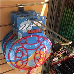 Surealistic and dream-catcher-like in appearance is this oversize Bubble-Wand Slatwall Loop Hook in-store presentation. Retail Fixtures, Store Fixtures, Spy Store, Bubble Wands, Curiosity Shop, Point Of Purchase, Slat Wall, Soap Bubbles, Retail Design