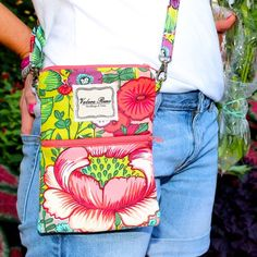 """#ValereRene Elli Crossbody Bag:  The Elli Bag is perfect for hands free fun! This bag fits a passport, wallet, phone and has an exterior pocket for extra convenience. There is also an adjustable strap, so ladies of any height can carry this bag comfortably.  $56.00 each.  8.25"""" H x 6.25"""" W    #ShopBellis #ShopBellisBoutique #BellisBoutique #GardenParty #Floral #CrossbodyBag"""