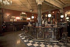 ceiling treatment, wainscot, foot rail, wood bar, tin ceiling