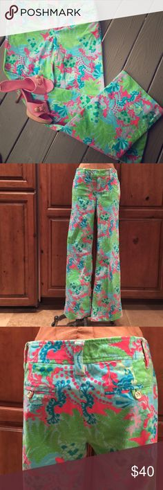 """Lilly Pulizer green blue gecko fern cords size 6 Fun whimsical print by Lilly Pulitzer.  Gecko and fern print on 99% cotton 1% spandex corduroy fabrication.  Front slash pockets and rear inset pockets.  Mens trouser zip front closure. Size 6 - waist 34"""", hips 38"""", inseam 34"""", overall length 41.5"""". Lilly Pulitzer Pants Boot Cut & Flare"""