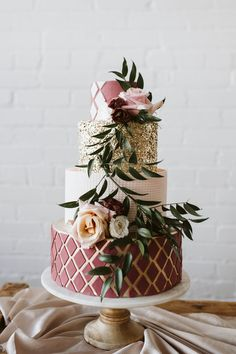 Professional 3 tier cake for a special occasion. Burgundy and gold with fresh flowers.