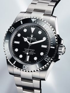 ROLEX Submariner 2012- only want it without the date.  Soon come.