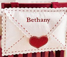 DIY Felt Valentine Envelopes {Pottery Barn Kids style} No Sewing Required :) easy and fun!  used 1 week prior to V day and put notes in.  tied to the kicthen chair.  kids love walking down each morning to find notes