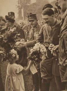 Adolf Hitler greeted by the German population in Sudetenland during a visit to Wildenau (1938). Description from pinterest.com. I searched for this on bing.com/images