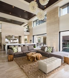 Contemporary living room, high ceilings, wood ceiling, shag rug, wood grain tile flooring, large stone | Blue Heron Design-Build