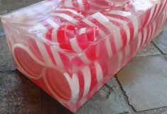 Peppermint curls soap loaf, Fresh Peppermint scent (true peppermint), red and white curls in glycerin soap loaf with glitter  Medium-Strong scent - one of my best sellers!  PLEASE ALLOW 5-8 BUSINESS DAYS BEFORE SHIPPING ON MULTI LAYER LOAVES. Layered soaps and soaps with curls are very timely to make but quite beautiful. It can take up to 6 hours to make 1 loaf. I want your product to be as clean,fragrant and fresh looking as possible so I do not STORE soap loaves. I make everything fresh as…