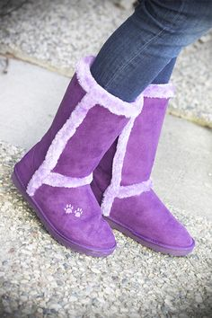 For every pair sold, we will donate another pair of shoes through Soles4Souls, a nonprofit organization giving shoes to those in need both in the U.S. and abroad! Cold weather is no excuse to ditch your fashion sense! This micro-suede boot has Supercozy™ accent fur and soft faux fur lining, ready to keep your feet extra toasty. An added paw print on each boot displays your support for rescued animals.