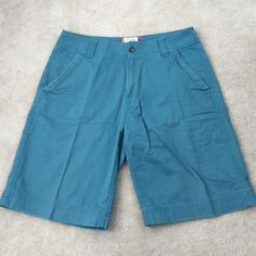 Men's Mossimo Teal Shorts Good condition men's Mossimo flat front teal colored shorts in size 32. Style is supposed to make shorts look 'worn' but they are in good condition except for the button hole, which is fraying a bit (shown in last pic). Still have lots of life left as they were only worn a handful of times! Accepting most offers! Mossimo Supply Co Shorts