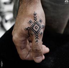 Geometric knuckle tattoo by Omer Shatz
