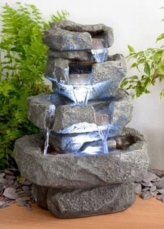 4 Tier Cascading Water Feature with LED Lights. Equally attractive at day or night.