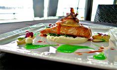 From our Bateaux Dubai menu: Scottish Salmon with Braised Artichoke, Green Beans Emulsion, Prawn Tortellini, and Crispy Potato.