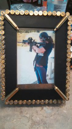 Hot glue bullet casings to a picture frame. I used 9mm for the border and AR15 for the inside.