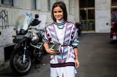 Miroslava Duma has it all! Statement necklace, charming prints and a high neck on top!