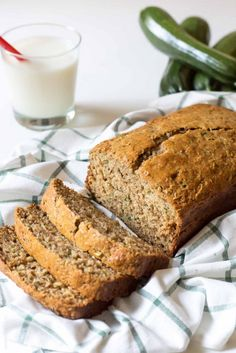Healthy Zucchini Bread Recipe - made with half the amount of sugar, whole wheat flour, greek yogurt & coconut oil. A healthier zucchini bread you can enjoy without the guilt! @tasteslovely