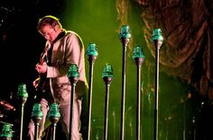 Bon Iver performs at Coachella 12; those varied-height green lights on stage are reminiscent of the palm trees in the area
