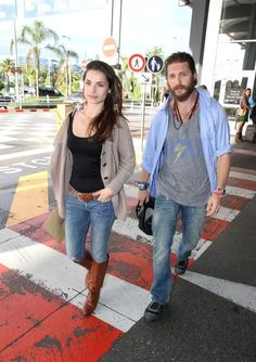 Tom Hardy and Charlotte Riley as they arrive in Nice Airport attend the 65th Annual Cannes Film Festival.