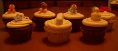 Assorted cupcakes with baby themed fondant decorations.