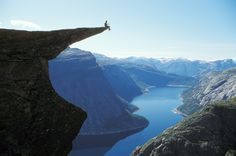 Trolltunga (meaning: troll's tongue) is a piece of rock that juts out horizontally from a mountain above Skjeggedal Valley, Odda, Norway. beautiful-places-to-visit Places To Travel, Places To See, Travel Destinations, Scary Places, Lofoten, Beautiful World, Beautiful Places, Amazing Places, Beautiful Norway