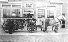 Horse drawn engine and crew outside of Portland Fire Station 19, 6049 SE Stark Street in Portland.