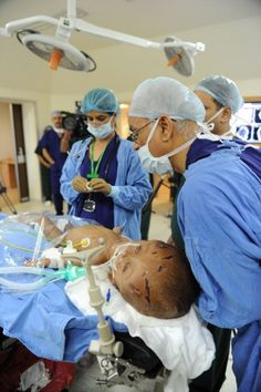 Indian doctors prepare Roona Begum, a 15-month old girl suffering from hydrocephalus (a buildup of fluid inside the skull that leads to swelling) for surgery at a hospital in Gurgaon on the outskirts of New Delhi. Doctors successfully carried out life-saving surgery on Roona. (Sajjad Hussain/AFP/Getty Images)
