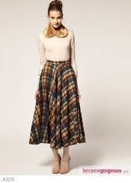 Image result for model wearing midi skirts and boots