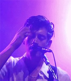 Alex turner brushing back his hair...perfect!