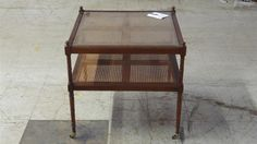 www.M37Auction.com: Baker-Milling Road End Table on Casters with Cane Inserts