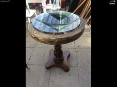 Wagon wheel table made from left over wood with a glass top