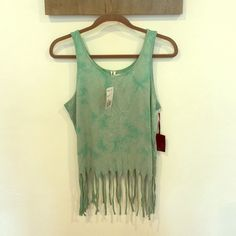 NWT forever21 fringe crop top. Size large NWT forever21 pistachio green fringed crop top with cool print. Adorable summery top. Size large (fits like medium) Selling cheaper!! Forever 21 Tops Crop Tops