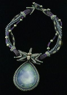 Laura McCabe Necklace... LOVE the look of the 3 different strands!!