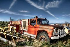 An old Amarillo Fire Department Ford truck abandoned on a lot in the mountains of New Mexico.  by flyingdogNM
