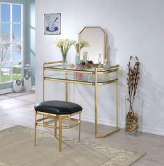 3 pc Colleen collection gold metal frame bedroom make up vanity sitting table set with mirror. This set features a mirror , bench and vanity. Vanity measures x x , Mirror measures x x H. Stool measures 18 x 15 x 16 H. Some assembly required. Glass Vanity Table, Makeup Table Vanity, Vanity Set With Mirror, Vanity Stool, Glass Table, Makeup Stool, Makeup Desk, Makeup Tables, Mirror Glass