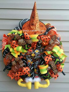 》Witch hat will be removed from wreath for shipping but can easily be re-attached《  This wreath is made with a black and white striped premium mesh, coordinating ribbons, ornaments, and coiled picks. It also features a handmade one of a kind witch booty and coordinating hat. This wreath is already made and ready to ship! **If hanging outside, please keep under a covered porch or stoop to prevent fading of the bright colors**