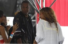 Jay Z, center, and Beyonce, right, hang out on the side of the Liberty stage as Gary Clark Jr. performs during the Made in America festival in Philadelphia, Pa. on September 2, 2012. The woman on the left is unidentified. ( DAVID MAIALETTI / staff photographer )
